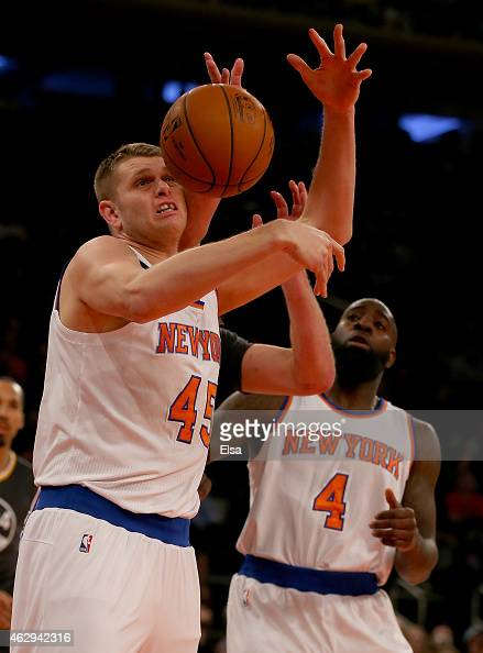 Cole Aldrich of the New York Knicks tries to hold on to the ball as teammate Quincy Acy looks on in the first half against the Golden State Warriors...
