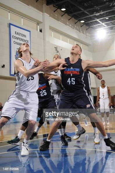 Cole Aldrich of the Oklahoma City Thunder battles for position against Kyle Singler of the Oklahoma City Thunder against the Detroit Pistons during...