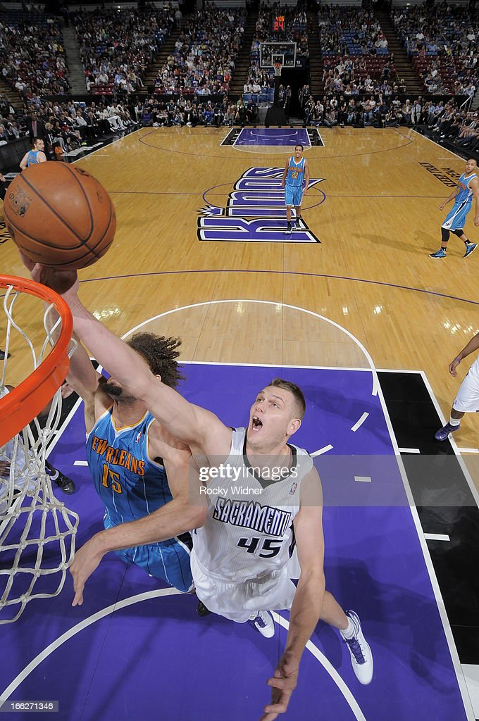 Cole Aldrich #45 of the Sacramento Kings blocks the shot of Robin Lopez #15 of the New Orleans Hornets on April 10, 2013 at Sleep Train Arena in Sacramento, California.