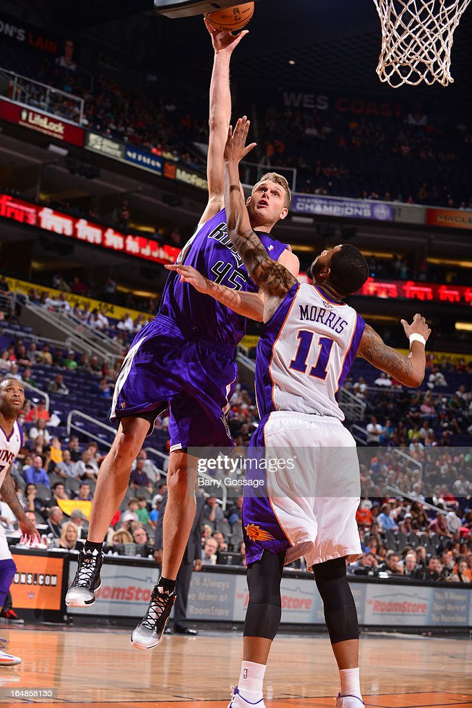 Cole Aldrich #45 of the Sacramento Kings shoots over Markieff Morris #11 of the Phoenix Suns on March 28, 2013 at U.S. Airways Center in Phoenix, Arizona.