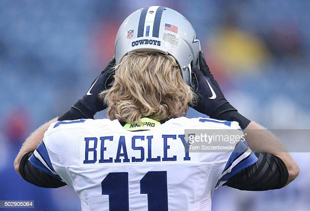 Cole Beasley of the Dallas Cowboys puts on his helmet as he warms up before playing against the Buffalo Bills during NFL game action at Ralph Wilson...