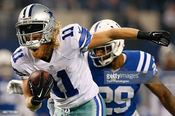 Cole Beasley of the Dallas Cowboys runs for a touchdown after making the catch against the Indianapolis Colts in the first half at ATT Stadium on...
