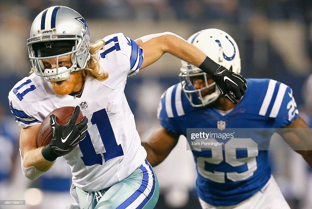 Cole Beasley #11 of the Dallas Cowboys runs for a touchdown after making the catch against the Indianapolis Colts in the first half at AT&T Stadium on December 21, 2014 in Arlington, Texas.