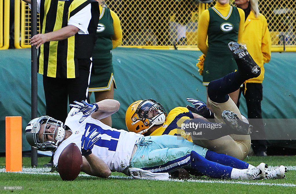 Cole Beasley #11 of the Dallas Cowboys scores a first quarter touchdown past Micah Hyde #33 of the Green Bay Packers at Lambeau Field on October 16, 2016 in Green Bay, Wisconsin.