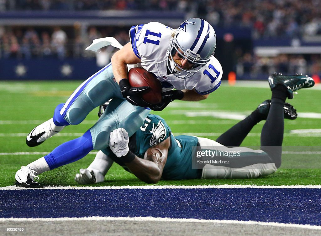 Cole Beasley of the Dallas Cowboys takes the ball across the goal line to score a touchdown against Malcolm Jenkins of the Philadelphia Eagles in the...