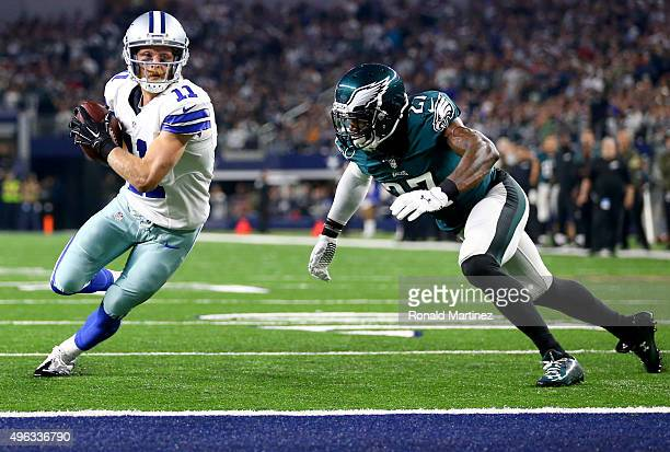 Cole Beasley of the Dallas Cowboys takes the ball to the goal line to score a touchdown against Malcolm Jenkins of the Philadelphia Eagles in the...
