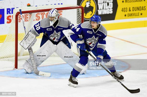 Cole Candella and Jake McGrath of the Sudbury Wolves watch the play develop against the Mississauga Steelheads during CHL game action on October 6...