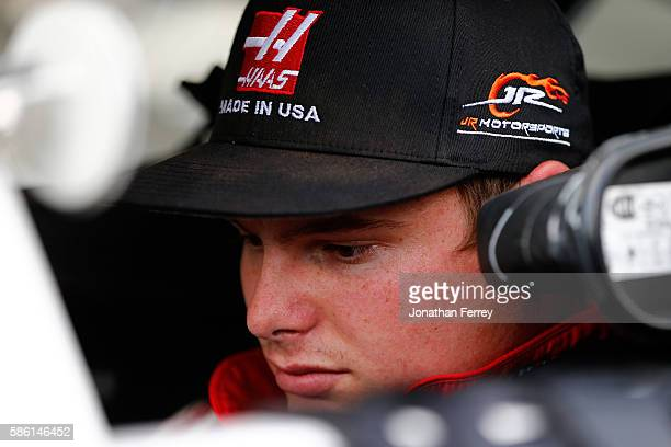 Cole Custer driver of the Automation Chevrolet sits in his car during qualifying for the NASCAR KN Pro East Series Bully Hill Vineyards 100 at...