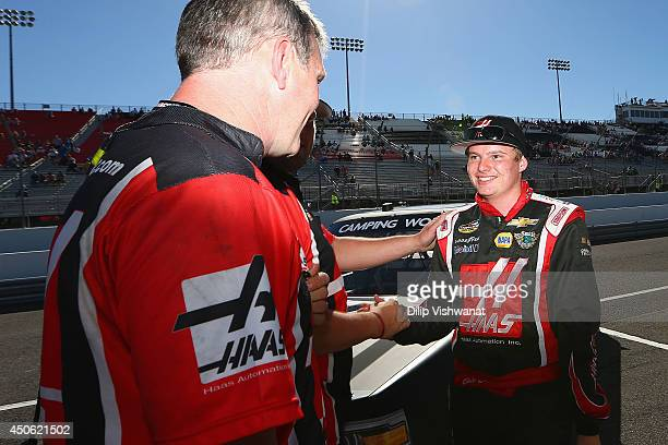Cole Custer driver of the Haas Automation Chevrolet is congratulated by his crew after qualifying for the pole position for the NASCAR Camping World...