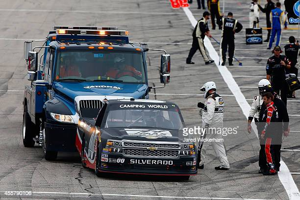 Cole Custer driver of the Haas Automation Chevrolet is pushed on pit road after his truck failed to start prior to the NASCAR Camping World Truck...