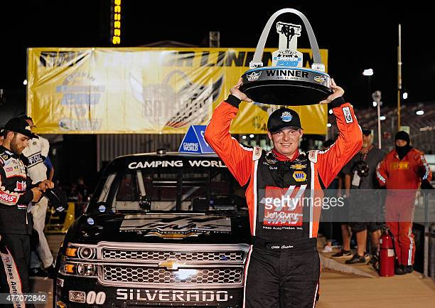Cole Custer driver of the Haas Automation Chevrolet poses for photos after winning the NASCAR Camping World Truck Series Drivin' for Linemen 200 at...