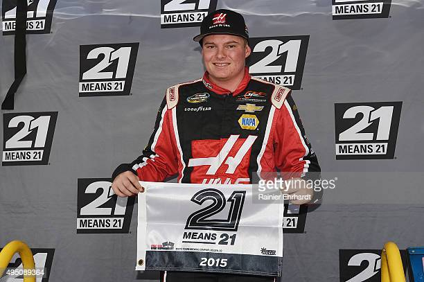 Cole Custer driver of the Haas Automation Chevrolet poses with the 21 Means 21 Pole Award after qualifying in the pole position for the NASCAR...