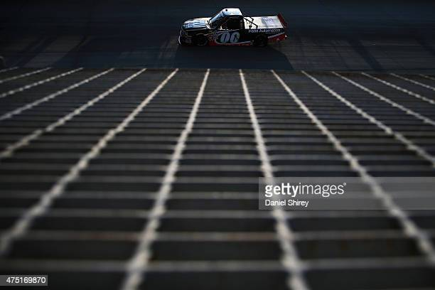Cole Custer driver of the Haas Automation Chevrolet races the NASCAR Camping World Truck Series Lucas Oil 200 at Dover International Speedway on May...