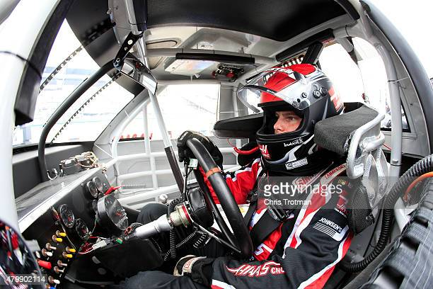 Cole Custer driver of the Haas Automation Chevrolet sits in his truck during qualifying for the NASCAR Camping World Truck Series Lucas Oil 200 at...