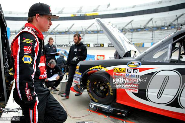 Cole Custer driver of the Haas Automation Chevrolet stands in the garage area during practice for the NASCAR Camping World Truck Series Kroger 250 at...