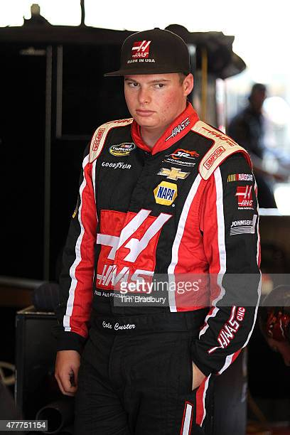 Cole Custer driver of the Haas Automation Chevrolet stands in the garage area during practice for the NASCAR Camping World Truck Series American...