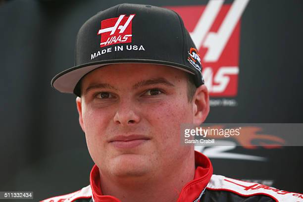 Cole Custer driver of the Haas Automation Chevrolet stands on the grid during qualifying for the NASCAR Camping World Truck Series NextEra Energy...