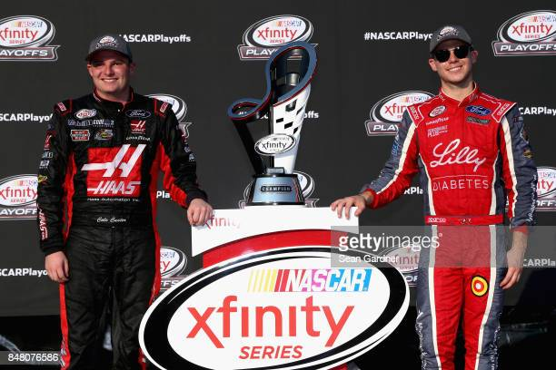 Cole Custer driver of the Haas Automation Ford and Ryan Reed driver of the Lilly Diabetes Ford pose for a photo opportunity following the NASCAR...