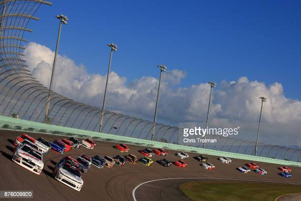 Cole Custer driver of the Haas Automation Ford and Tyler Reddick driver of the BBR/Granger Smith Chevrolet lead the field during the NASCAR XFINITY...