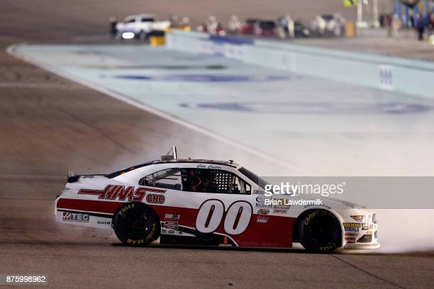 Cole Custer driver of the Haas Automation Ford celebrates with a burnout after winning the NASCAR XFINITY Series Championship Ford EcoBoost 300 at...
