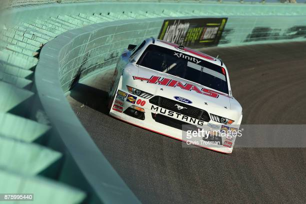 Cole Custer driver of the Haas Automation Ford races during the NASCAR XFINITY Series Championship Ford EcoBoost 300 at HomesteadMiami Speedway on...