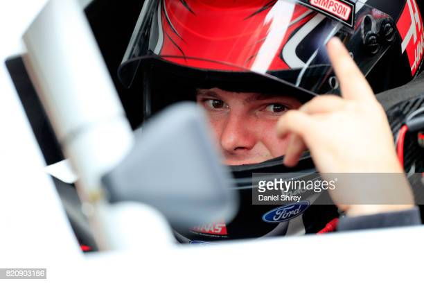 Cole Custer driver of the Haas Automation Ford sits in his car during qualifying for the NASCAR XFINITY Series Lilly Diabetes 250 at Indianapolis...