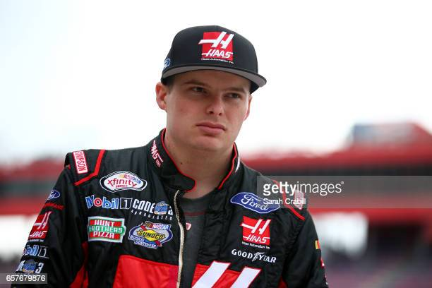 Cole Custer driver of the Haas Automation Ford walks to his car during qualifying for the NASCAR XFINITY Series Service King 300 at Auto Club...
