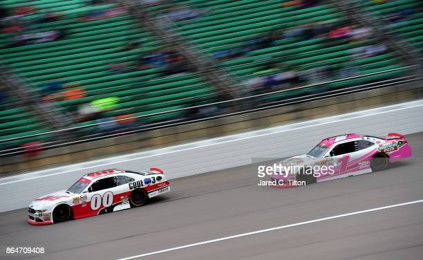 Cole Custer driver of the Haas/Code 3 Associates Ford leads Elliott Sadler driver of the Hunt Brothers Pizza Chevrolet during the NASCAR XFINITY...