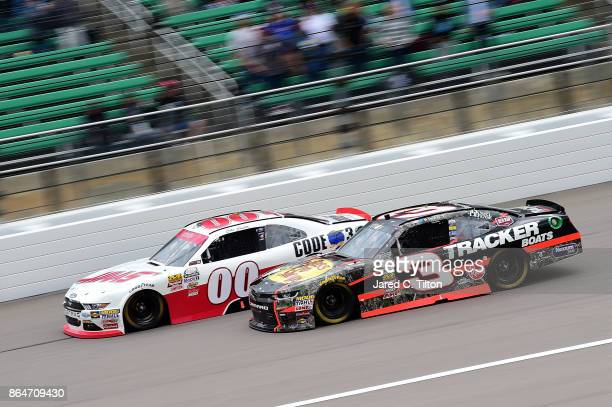 Cole Custer driver of the Haas/Code 3 Associates Ford races Ty Dillon driver of the Bass Pro Shops/Tracker Boats Chevrolet during the NASCAR XFINITY...