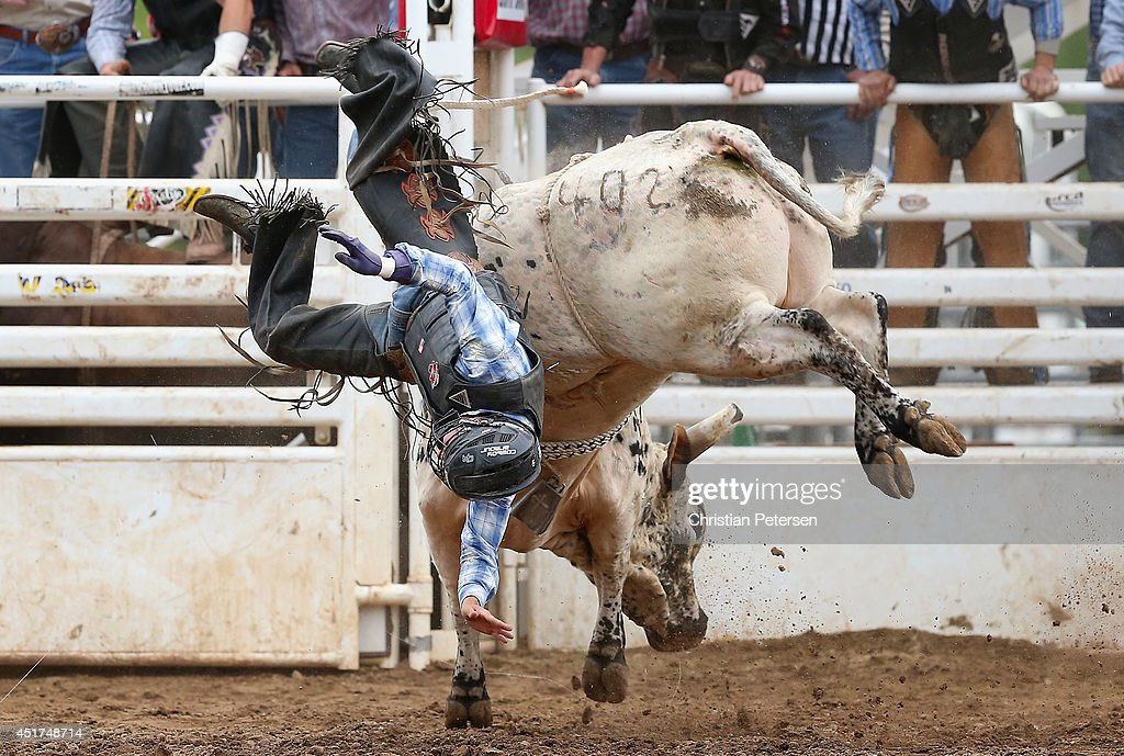 Cole Echols is thrown from the bull as he competes in the Bull Riding at the Prescott Frontier Days 'World's Oldest Rodeo' on July 5, 2014 in Prescott, Arizona.
