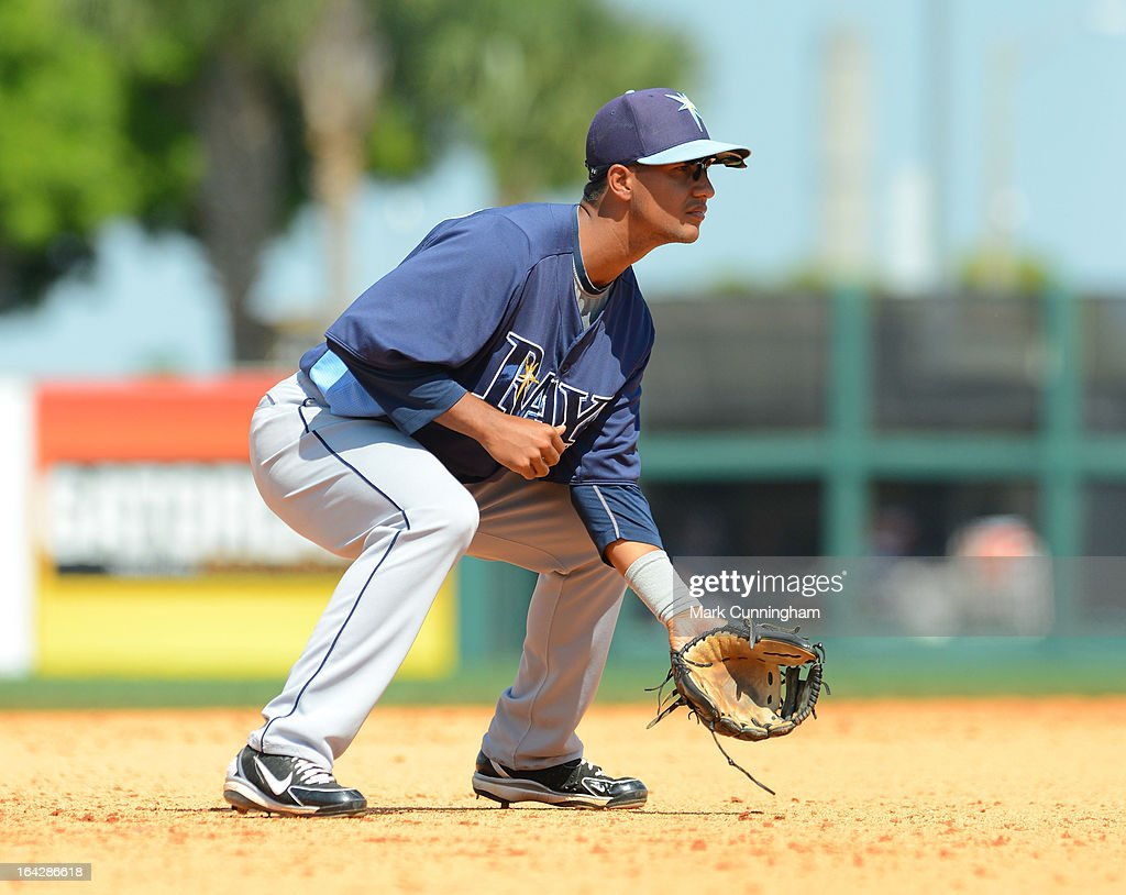 Cole Figueroa #87 of the Tampa Bay Rays fields during the spring training game against the Detroit Tigers at Joker Marchant Stadium on March 19, 2013 in Lakeland, Florida. The Rays defeated the Tigers 11-5.