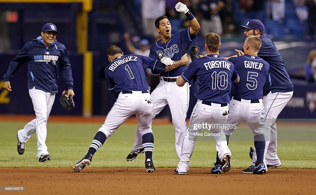 Cole Figueroa of the Tampa Bay Rays is congratulated by teammates after hitting a walkoff RBI double in the ninth inning of a baseball game against...