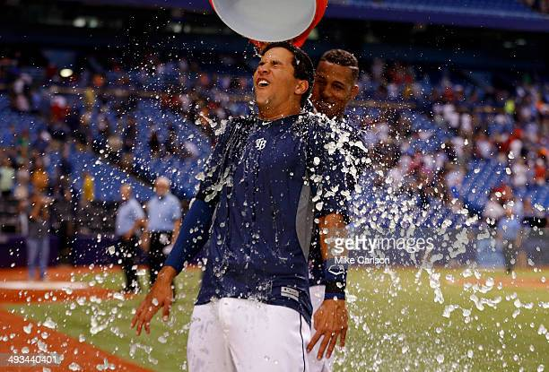 Cole Figueroa of the Tampa Bay Rays is doused with Gatorade by teammate Yunel Escobar after his walkoff RBI double in the ninth inning of a baseball...