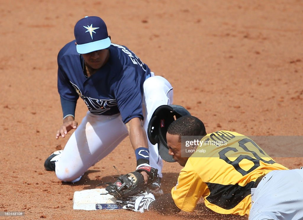 Cole Figueroa #87 of the Tampa Bay Rays makes the force out at second base on Darren Ford #60 of the Pittsburgh Pirates during the Spring Training game on February 23, 2013 in Port Charlotte, Florida.