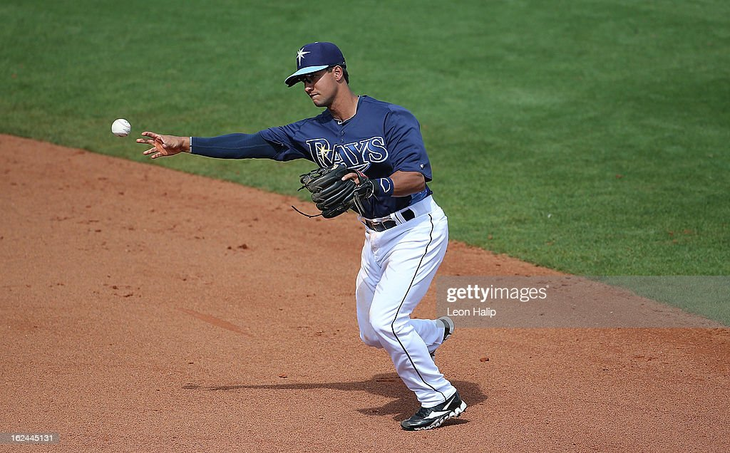 Cole Figueroa #87 of the Tampa Bay Rays makes the throw to first base during the Spring Training game against the Pittsburgh Pirates on February 23, 2013 in Port Charlotte, Florida. The Pirates defeated the Rays' 3-2.
