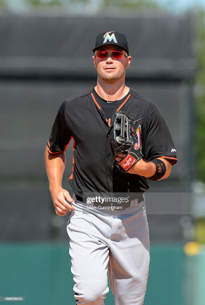 Cole Gillespie #28 of the Miami Marlins looks on during the Spring Training game against the Detroit Tigers at Joker Marchant Stadium on March 25, 2015 in Lakeland, Florida. The Tigers defeated the Marlins 8-4.