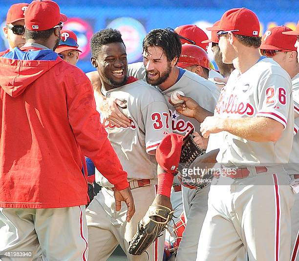 Cole Hamels of the Philadelphia Phillies and Odubel Herrera celebrate on July 25 2015 at Wrigley Field in Chicago Illinois Cole Hamels of the...