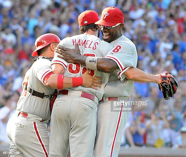 Cole Hamels of the Philadelphia Phillies celebrates his no hitter with Ryan Howard and Carlos Ruiz July 25 2015 at Wrigley Field in Chicago...