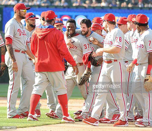 Cole Hamels of the Philadelphia Phillies celebrates his no hitter with his teammates July 25 2015 at Wrigley Field in Chicago Illinois Hamels pitched...