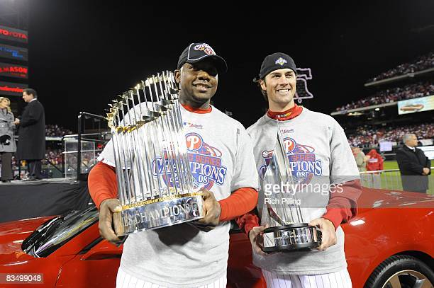 Cole Hamels of the Philadelphia Phillies holds the World Series MVP trophy and Ryan Howard of the Philadelphia Phillies holds the World Series...