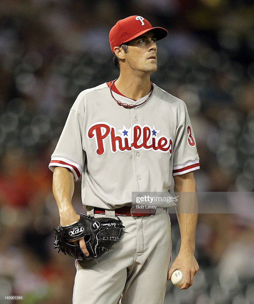 <a gi-track='captionPersonalityLinkClicked' href=/galleries/search?phrase=Cole+Hamels&family=editorial&specificpeople=565675 ng-click='$event.stopPropagation()'>Cole Hamels</a> #35 of the Philadelphia Phillies looks up at the screen after giving up a two-run home run to Matt Downs of the Houston Astros in the fourth inning at Minute Maid Park on September 14, 2012 in Houston, Texas.