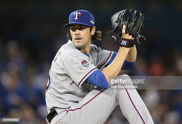 Cole Hamels of the Texas Rangers delivers a pitch against the Toronto Blue Jays during game five of the American League Division Series at Rogers...