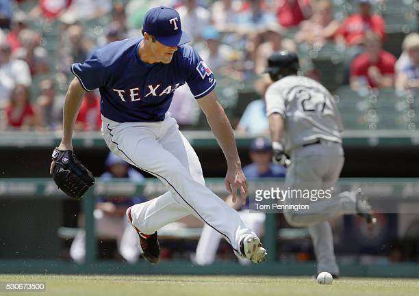Cole Hamels of the Texas Rangers fields a line drive against Dioner Navarro of the Chicago White Sox in the bottom of the third inning at Globe Life...