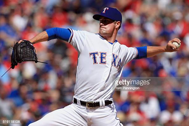 Cole Hamels of the Texas Rangers pitches against the Seattle Mariners in the top outfield the second inning on Opening Day at Globe Life Park in...