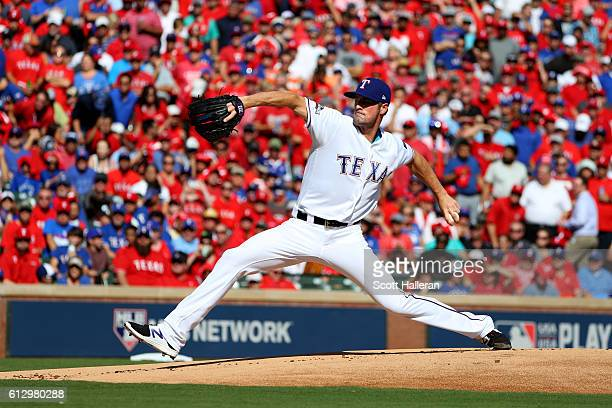 Cole Hamels of the Texas Rangers throws a pitch against the Toronto Blue Jays during the first inning in game one of the American League Divison...