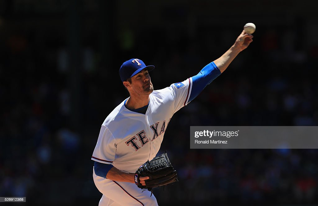 <a gi-track='captionPersonalityLinkClicked' href=/galleries/search?phrase=Cole+Hamels&family=editorial&specificpeople=565675 ng-click='$event.stopPropagation()'>Cole Hamels</a> #35 of the Texas Rangers throws against the Los Angeles Angels in the first inning at Globe Life Park in Arlington on May 1, 2016 in Arlington, Texas.