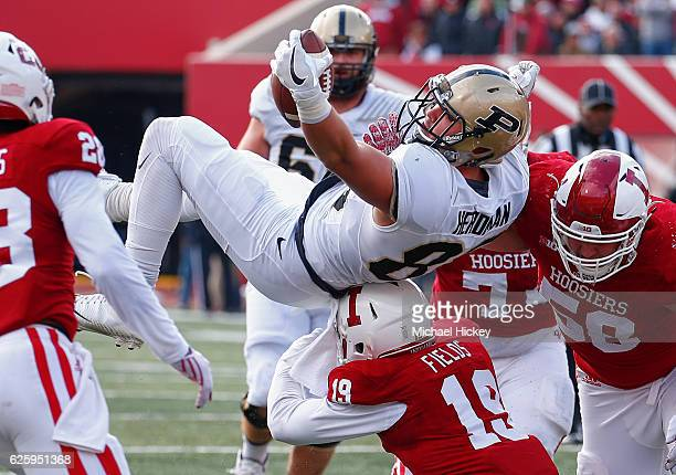 Cole Herdman of the Purdue Boilermakers is tackled by Tony Fields of the Indiana Hoosiers at Memorial Stadium on November 26 2016 in Bloomington...