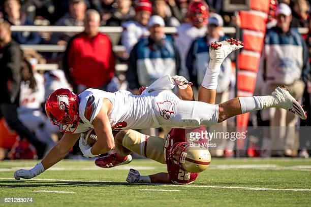 Cole Hikutini of Louisville dives above Matt Milano of Boston College during the third quarter of a game at Alumni Stadium on November 5 2016 in...