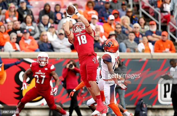 Cole Hikutini of the Louisville Cardinals catches a touchdown pass during the game against the Syracuse Orange at Papa John's Cardinal Stadium on...