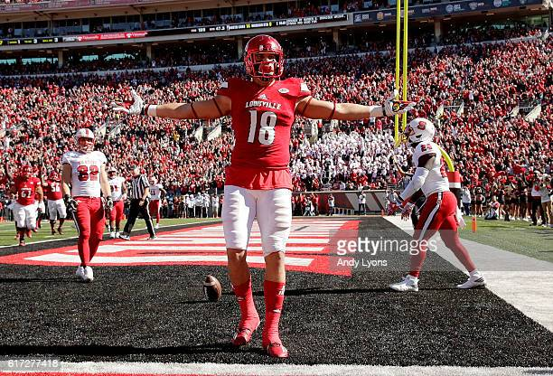 Cole Hikutini of the Louisville Cardinals celebrates after scoring a touchdown during the game against the North Carolina State Wolfpack at Papa...